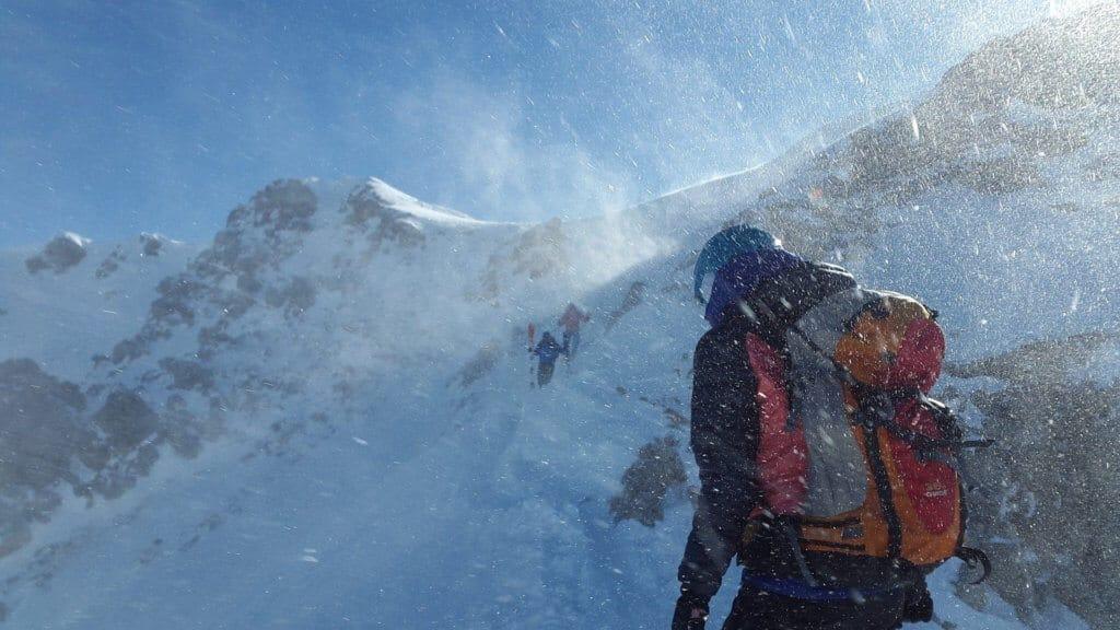 Mountaineer facing high wind