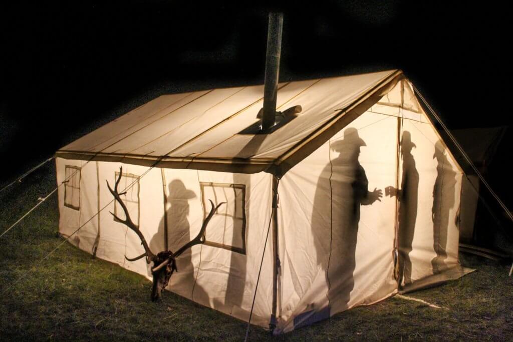 men in a tent