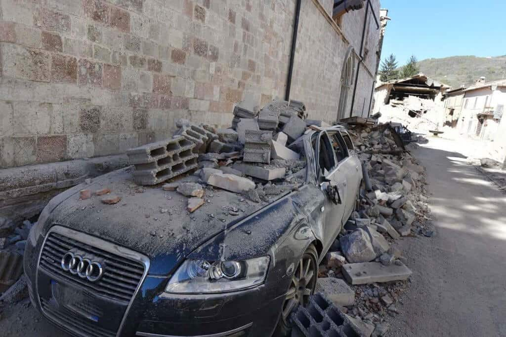 Earthquake and damaged car