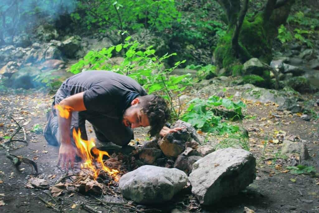 Survivalist making a fire